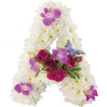 Massed letter with seasonal flowers from £39.90